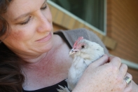 Dot and myself having a cuddle. She is the most passive and friendly chook we have at the ripe old age of nearly 10.