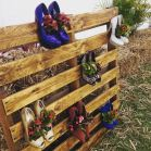 a colourful display of shoes used as wall planters