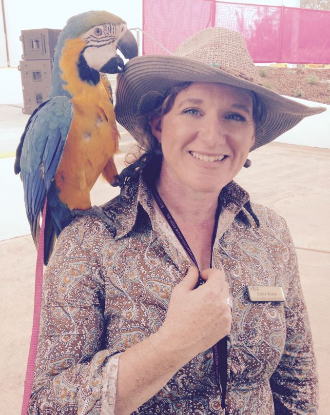 Claire with a Macaw on her shoulder