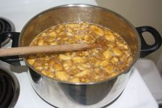 Simmering mashed bananas on a stove top